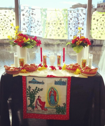 The center altar, with papel picado visible in the background.