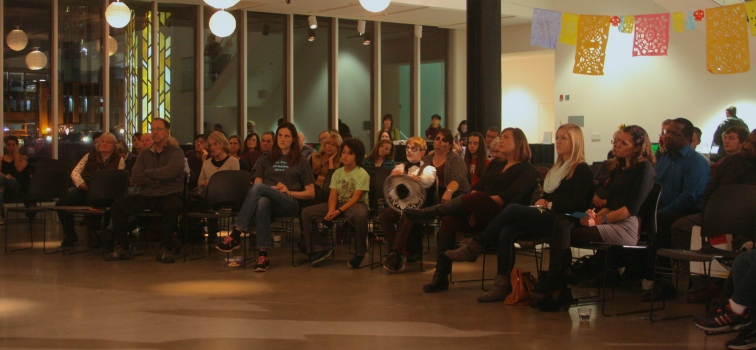 A shot of the audience in the Grand Lobby of the Rochester Art Center.