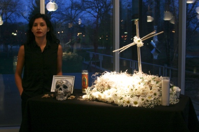 Karla Giguere standing by the altar she designed and created.