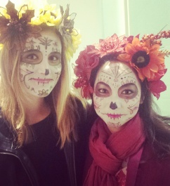 Two women wear calavera style makeup. Photo courtesy of Susannah Magers.